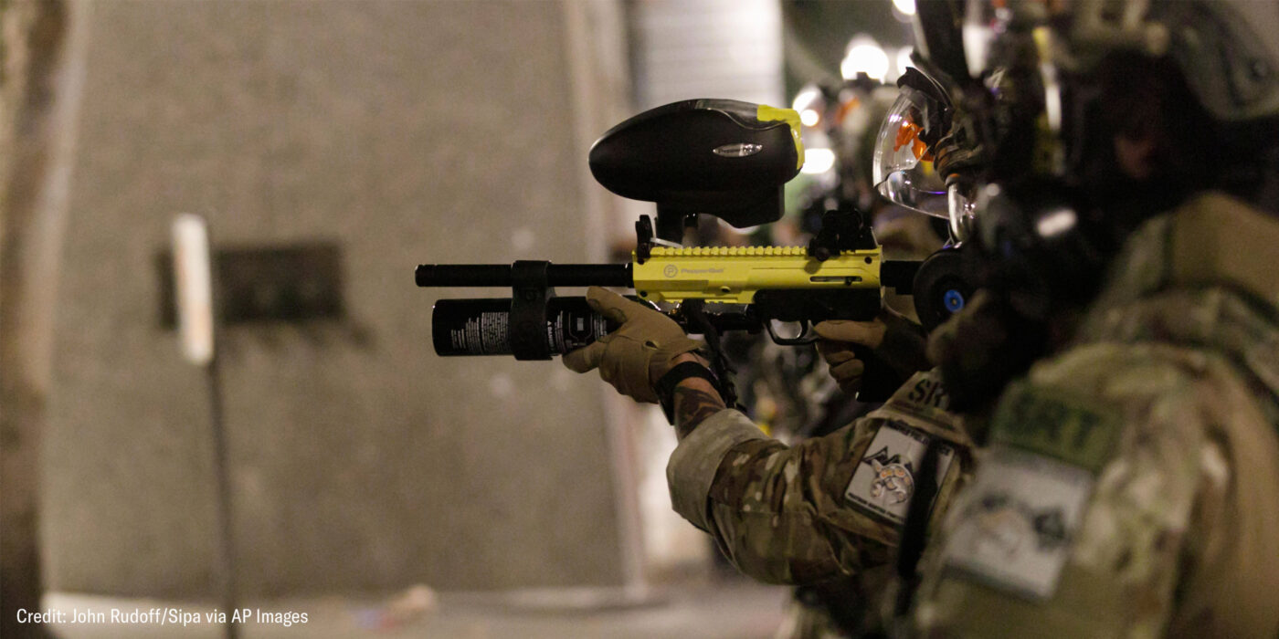 Federal SRT officers shoot less-lethal munitions at protesters.