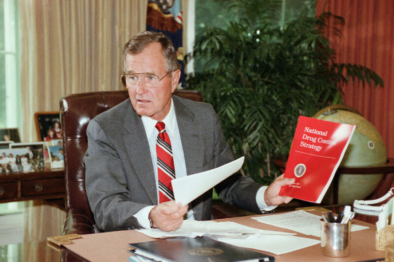 President George H. Bush holds up a copy of the National Drug Control Strategy