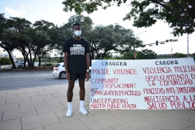 Aaron Booe poses for a picture at a demonstration in Austin, Texas.