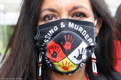 Jeannie Hovland, the deputy assistant secretary for Native American Affairs for the U.S. Department of Health and Human Services, poses with a Missing and Murdered Indigenous Women mask.